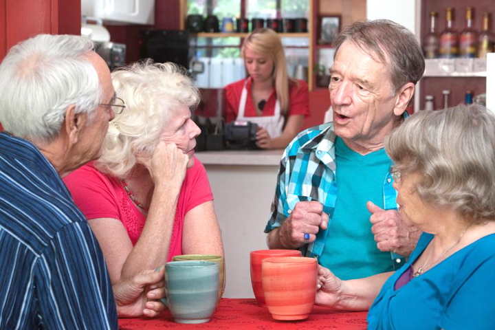 16926104 - four caucasian senior adults with coffee mugs in conversation